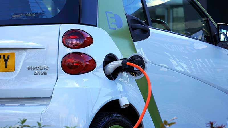 Jose Mier charges electric car in Sun Valley, CA